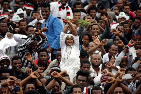 A demonstrator chants slogans while flashing the Oromo protest gesture during celebrations for Irreecha, the thanksgiving festival of the Oromo people, in Bishoftu town, Oromia region