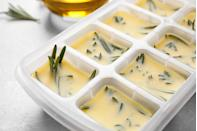 """<p>While herbs may seem like one of those <a href=""""https://www.thedailymeal.com/cook/foods-never-freeze?referrer=yahoo&category=beauty_food&include_utm=1&utm_medium=referral&utm_source=yahoo&utm_campaign=feed"""" rel=""""nofollow noopener"""" target=""""_blank"""" data-ylk=""""slk:foods that don't freeze well"""" class=""""link rapid-noclick-resp"""">foods that don't freeze well</a>, they can if you do it right. Fill an ice cube tray halfway with cut herbs, then top it off with some olive oil and place the ice cube tray in the freezer. Once the cubes are frozen solid, you can store them in a sealed plastic bag or container and use them to add flavor to dishes on a whim.</p>"""