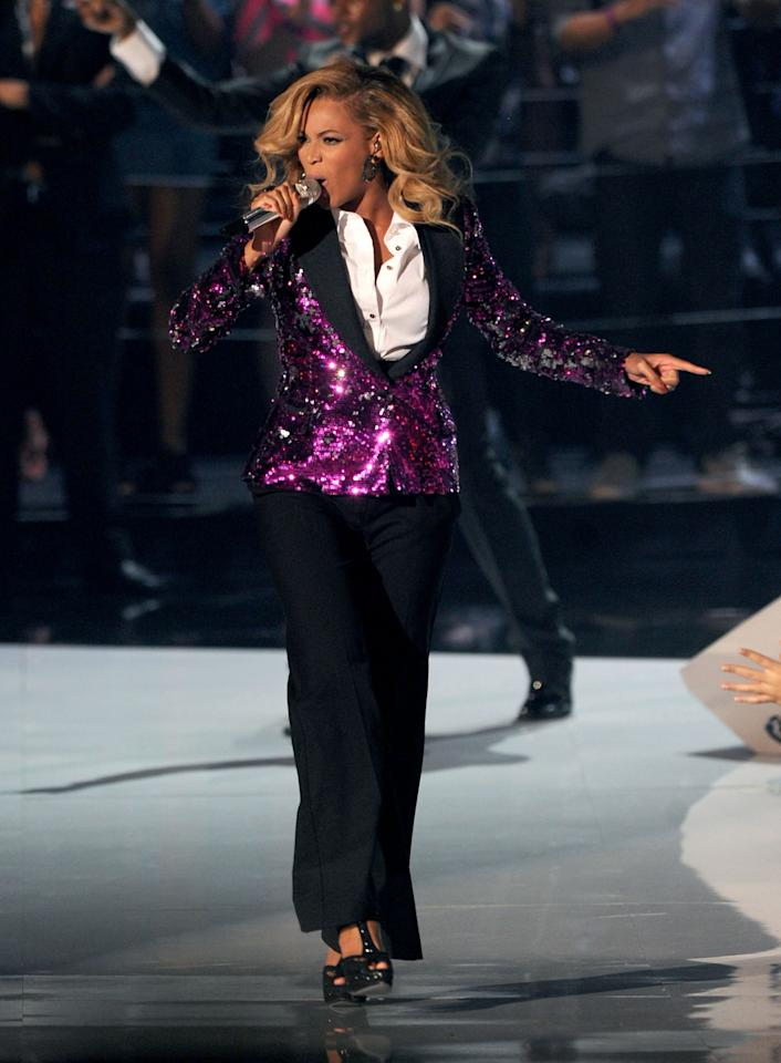 <p>Beyonce announced her first pregnancy in a purple sequinned Dolce & Gabbana tux straight after her 2011 VMAs performance. <i>[Photo: Getty]</i> </p>