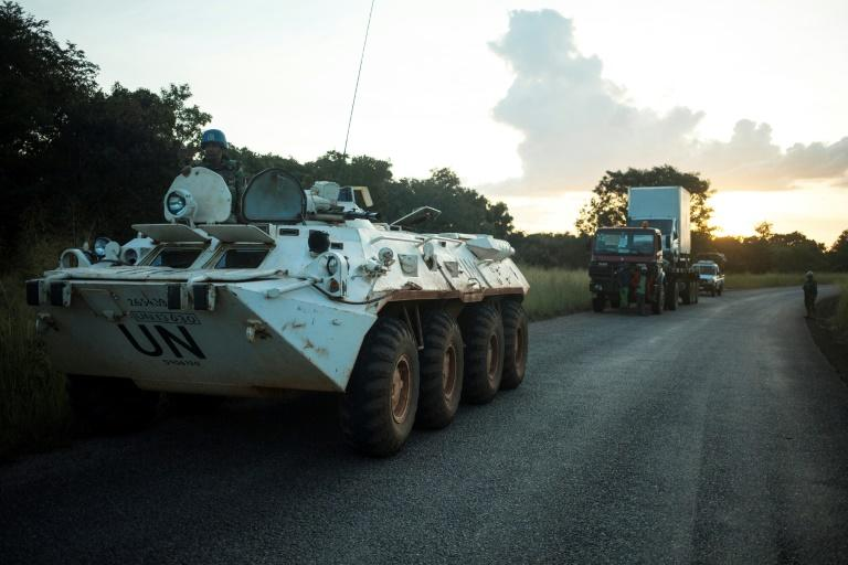 A MINUSCA patrol in the Central African Republic secures a truck experiencing engine failure on the road between Bouar and Bangui in October 2017