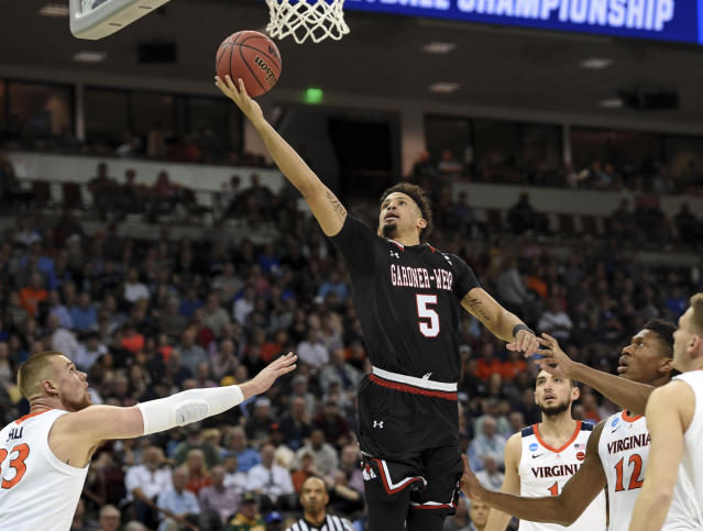 Gardner-Webb's Jose Perez (5) drives to the basket past Virginia's Jack Salt (33) during a first-round game in the NCAA mens college basketball tournament in Columbia, S.C., Friday, March 22, 2019. (AP Photo/Richard Shiro)