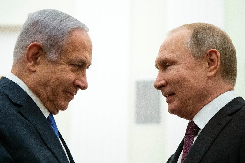 Netanyahu (L) visited Putin (R) in Moscow five days before he is to seek a fifth term in office in a difficult election