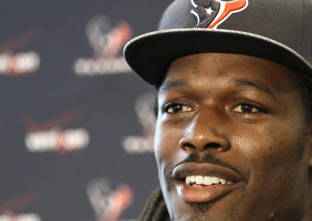 Houston Texans No. 1 overall NFL draft pick Jadeveon Clowney, a defensive end from South Carolina, meets the press during an introductory NFL football news conference Friday, May 9, 2014, in Houston. (AP Photo/Pat Sullivan)