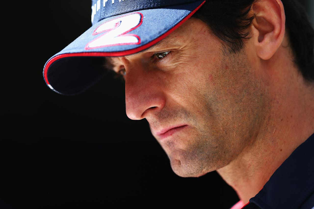 MELBOURNE, AUSTRALIA - MARCH 14:  Mark Webber of Australia and Infiniti Red Bull Racing talks in the paddock during previews to the Australian Formula One Grand Prix at the Albert Park Circuit on March 14, 2013 in Melbourne, Australia.  (Photo by Clive Mason/Getty Images)