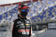 Driver Brad Keselowski walks to his car for the start of the NASCAR Cup Series auto race Sunday, May 17, 2020, in Darlington, S.C. (AP Photo/Brynn Anderson)