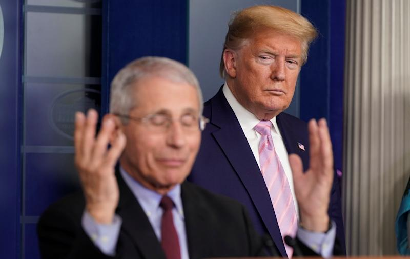 U.S. President Donald Trump listens as Dr. Anthony Fauci, director of the National Institute of Allergy and Infectious Diseases, addresses the daily coronavirus task force briefing at the White House in Washington, U.S., April 4, 2020. REUTERS/Joshua Roberts