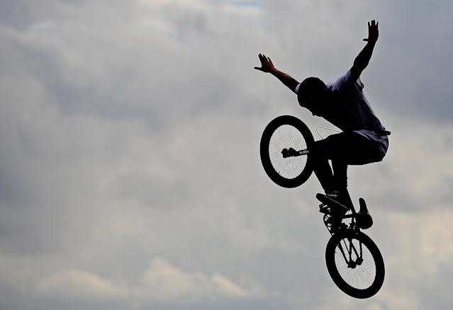 Aug 8, 2012; London, United Kingdom; A BMX stunt performer during qualifying for men's BMX in the London 2012 Olympic Games BMX Track. Mandatory Credit: Andrew Weber-USA TODAY Sports