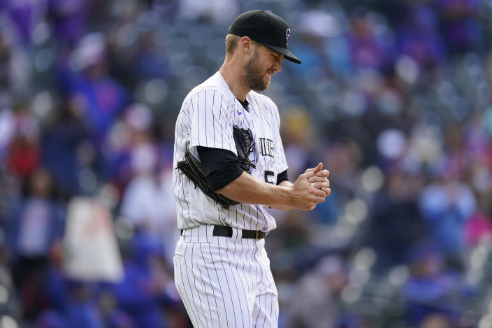 Colorado Rockies relief pitcher Daniel Bard rubs up a ball after giving up an RBI single to New York Mets' Francisco Lindor during the seventh inning of a baseball game Saturday, April 17, 2021, in Denver. The Mets won 4-3 in the first game of a doubleheader. (AP Photo/David Zalubowski)
