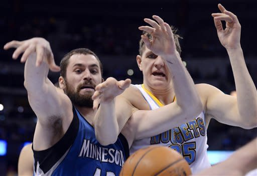 Minnesota Timberwolves forward Kevin Love, left, and Denver Nuggets center Timofey Mozgov (25), from Russia, eye a loose ball during the second quarter of an NBA basketball game on Thursday, Jan. 3, 2013, in Denver. (AP Photo/Jack Dempsey)