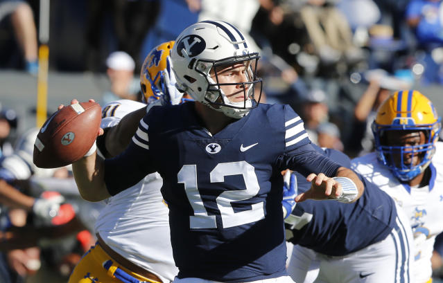 BYU quarterback Tanner Mangum (12) looks down field against McNeese State in the first half during an NCAA college football game Saturday, Sept. 22, 2018, in Provo, Utah. (AP Photo/Rick Bowmer)