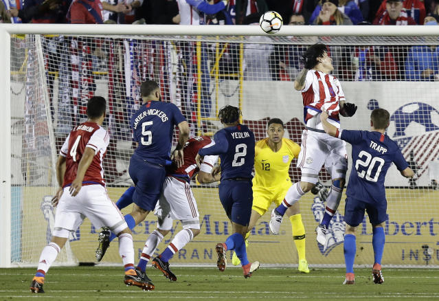 United States goalie Zack Steffen (12) defends with DeAndre Yedlin (2) and Wil Trapp (20) against Paraguay's Federico Santander during the first half of an international friendly soccer match in Cary, N.C., Tuesday, March 27, 2018. (AP Photo/Gerry Broome)