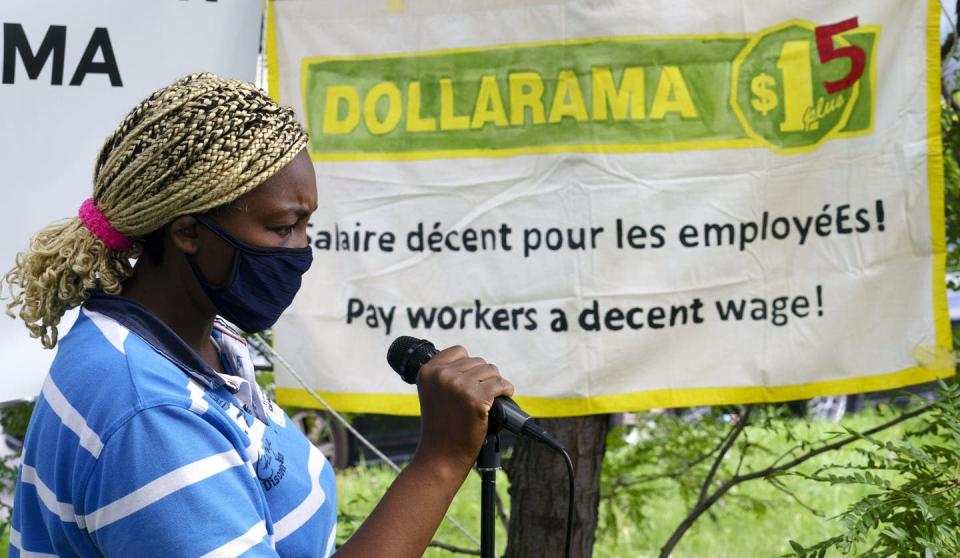 "<span class=""caption"">Dollarama worker Ze Carole Benedict, originally from Cameroon, addresses a demonstration in Montréal in August 2020 to join in calls for higher pay and better working conditions amid COVID-19.</span> <span class=""attribution""><span class=""source"">THE CANADIAN PRESS/Paul Chiasson</span></span>"