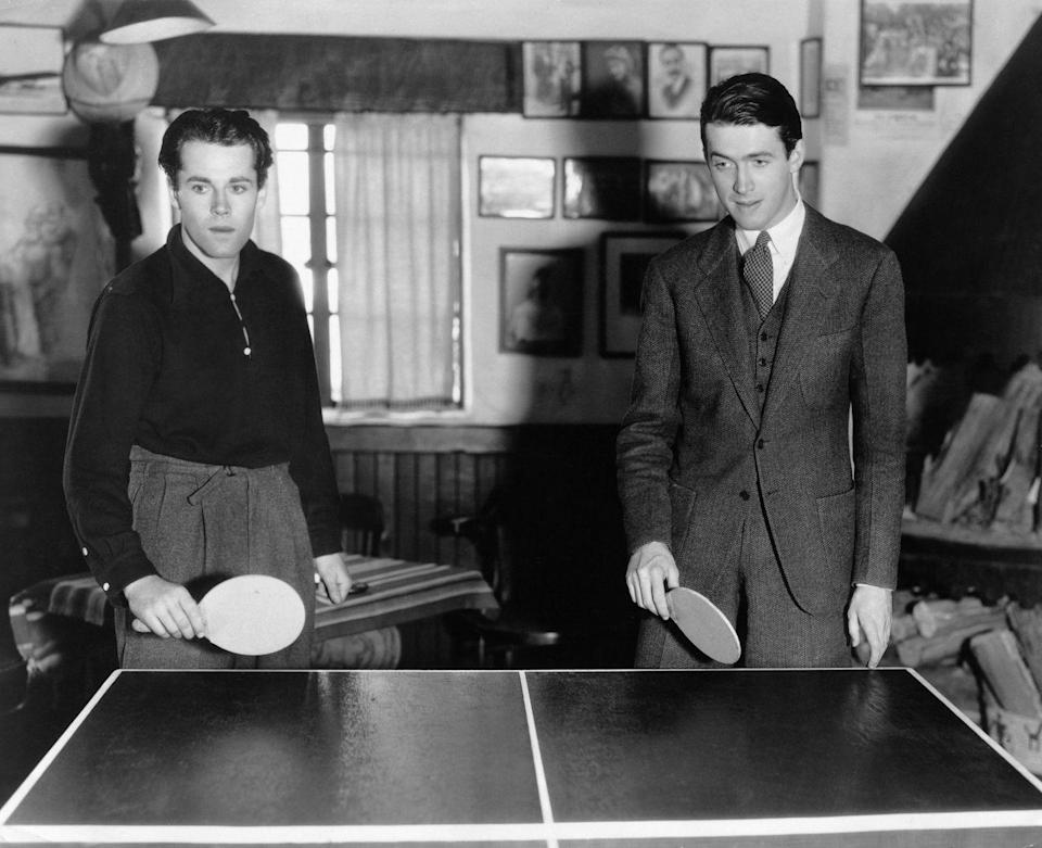 <p>Henry Fonda and James Stewart play a game of ping pong, circa 1937.</p>