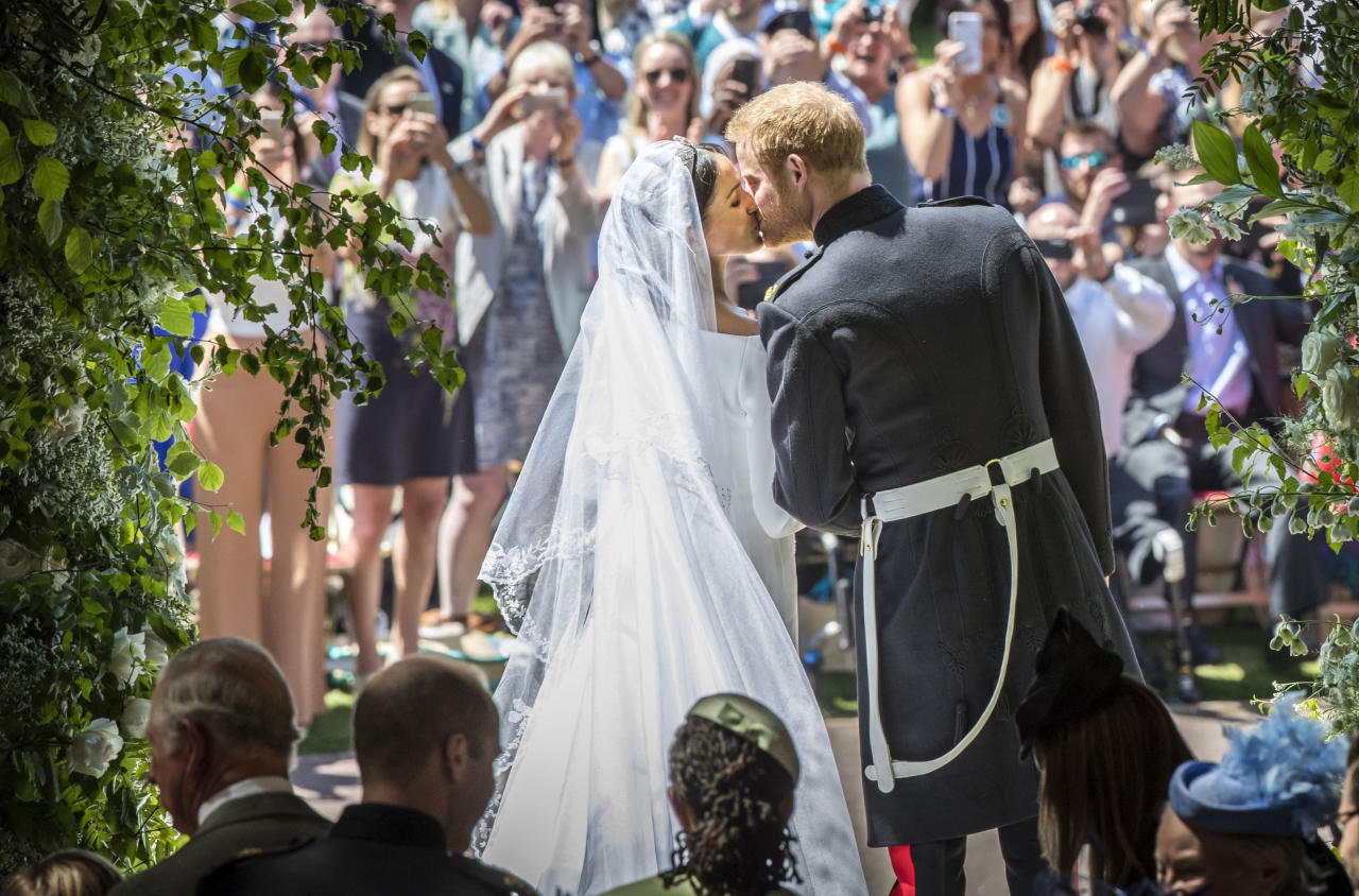 <p>The Duke and Duchess of Sussex kiss on their wedding day outside St George's Chapel (Getty) </p>