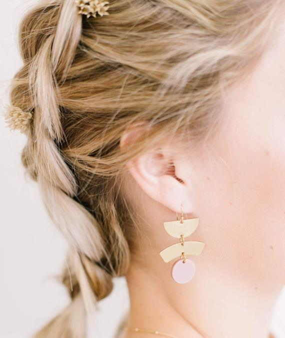 """<p><strong>Laceandpearlsjewelry</strong></p><p>etsy.com</p><p><strong>$36.00</strong></p><p><a href=""""https://go.redirectingat.com?id=74968X1596630&url=https%3A%2F%2Fwww.etsy.com%2Flisting%2F796918674%2Fgeometric-blush-brass-earrings&sref=https%3A%2F%2Fwww.goodhousekeeping.com%2Fholidays%2Fgift-ideas%2Fg436%2Fgifts-under-thirty-dollars%2F"""" rel=""""nofollow noopener"""" target=""""_blank"""" data-ylk=""""slk:Shop Now"""" class=""""link rapid-noclick-resp"""">Shop Now</a></p><p>These dainty earrings <a href=""""https://www.goodhousekeeping.com/holidays/gift-ideas/g1266/handmade-gifts/"""" rel=""""nofollow noopener"""" target=""""_blank"""" data-ylk=""""slk:were handmade"""" class=""""link rapid-noclick-resp"""">were handmade</a> (as were all the other pieces from this Etsy shop). They make a unique gift idea for the woman in your life who has everything.</p>"""