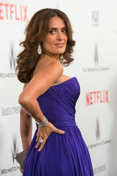 Actress Salma Hayek, pictured at a Golden Globes party co-hosted by The Weinstein Company in 2015, says the movie mogul threatened to break her kneecaps