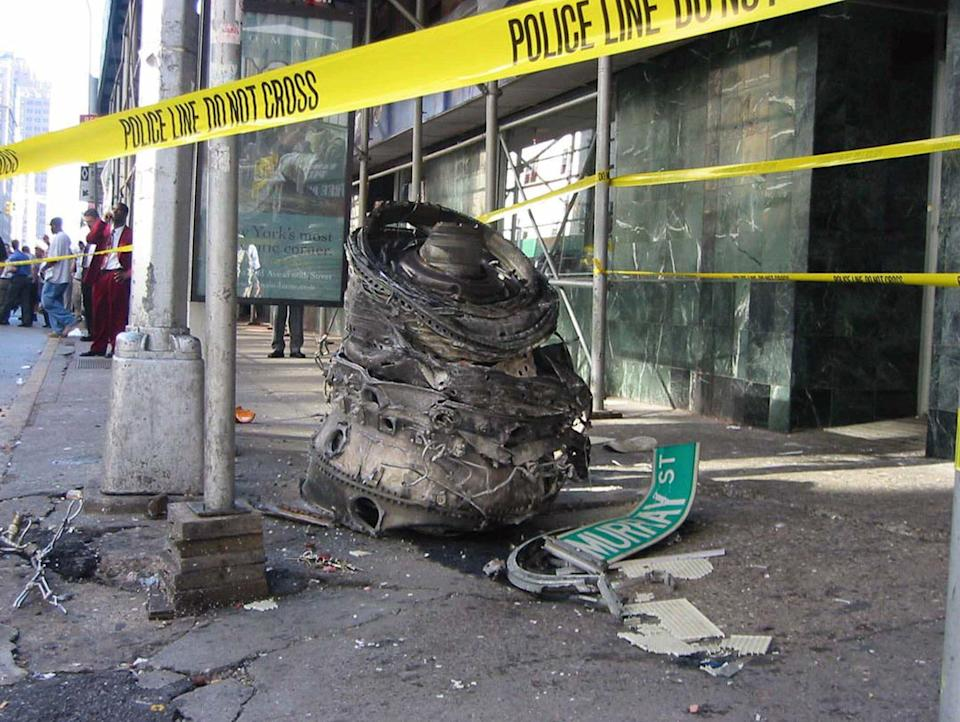 <p>A piece of debris from one of the crashed airliners lies on the corner of Murray Street in lower Manhattan near the World Trade Center site on Sept. 11, 2001. (Photo: Chris Kline/AP) </p>