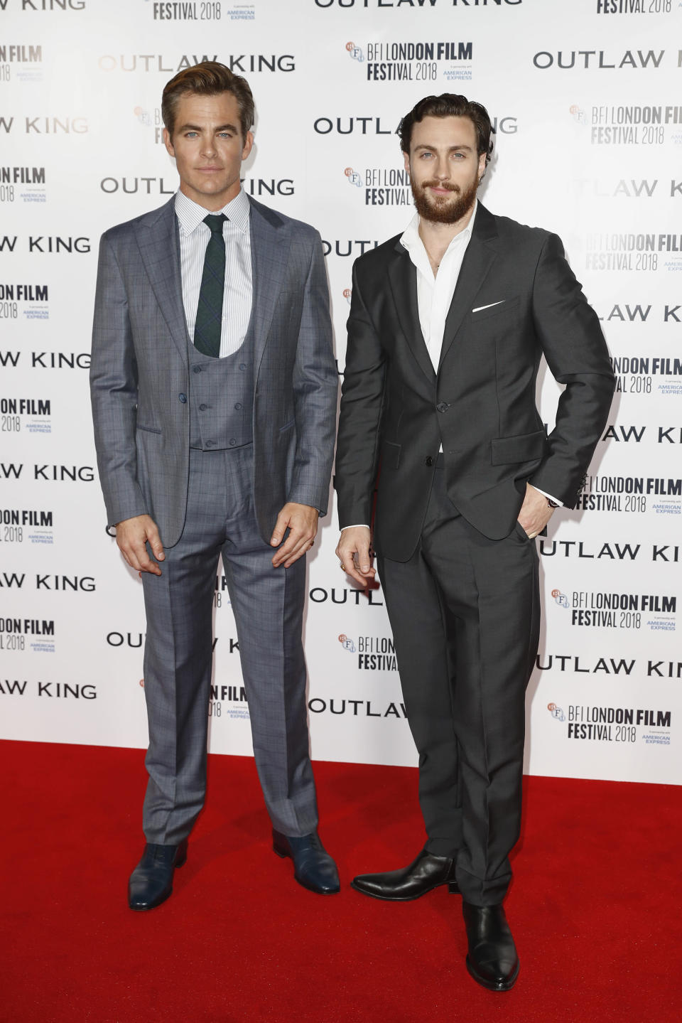 <p>Chris, clad in a green, skinny tie and tails and Aaron, sans tie but looked sharp nonetheless, took to the red carpet at the BFI London Film Festival. <em>[Photo: Getty]</em> </p>