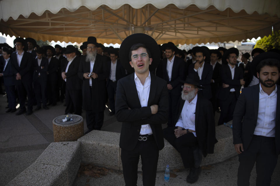 Ultra-Orthodox Jews mourn during the funeral of Moshe Ben Shalom at a cemetery in Petah Tikva, Israel, Friday, April 30, 2021. Moshe Ben Shalom and several others died and others were injured during a stampede at Lag BaOmer celebrations, a religious festival attended by tens of thousands of ultra-Orthodox Jews in Mt. Meron, northern Israel early Friday. It was one of the country's deadliest civilian disasters (AP Photo/Oded Balilty)