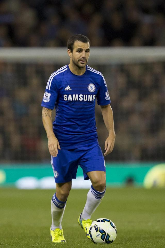 Chelsea's Cesc Fabregas takes the ball downfield during his team's English Premier League soccer match against Burnley at Turf Moor Stadium, Burnley, England, Monday Aug. 18, 2014. (AP Photo/Jon Super)