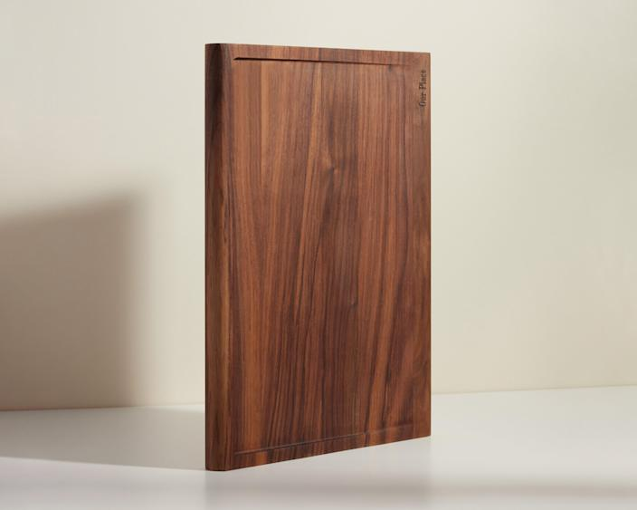 """$95, Our Place. <a href=""""https://fromourplace.com/products/walnut-cutting-board"""" rel=""""nofollow noopener"""" target=""""_blank"""" data-ylk=""""slk:Get it now!"""" class=""""link rapid-noclick-resp"""">Get it now!</a>"""