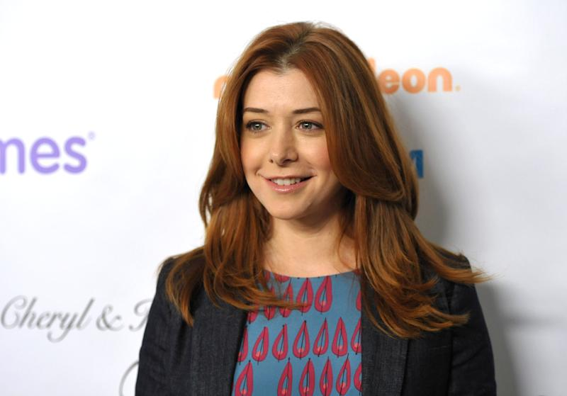 """FILE - This Dec. 7, 2012 file photo shows actress Alyson Hannigan from the CBS comedy, """"How I Met Your Mother,"""" at the March of Dimes Celebration of Babies in Beverly Hills, Calif. Hannigan obtained a temporary restraining order on Wednesday, Feb. 13, 2013 claiming a New Hampshire man recently released from a mental institution has been threatening to kill her and harm her family in online postings. (Photo by John Shearer/Invision/AP, file)"""