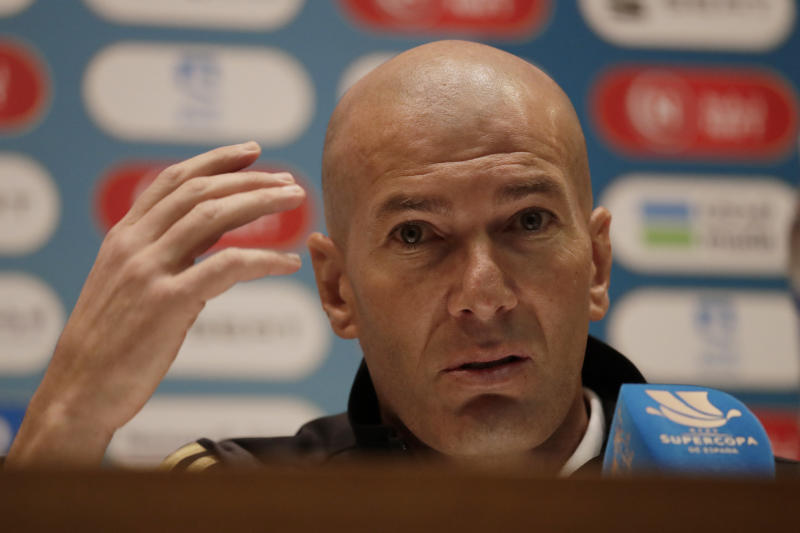 Real Madrid's head coach Zinedine Zidane speaks during a press conference at King Abdullah stadium, in Jiddah, Saudi Arabia, Saturday, Jan. 11, 2020, ahead of the Spanish Super Cup Final soccer match between Real Madrid and Atletico Madrid on Sunday. (AP Photo/Hassan Ammar)