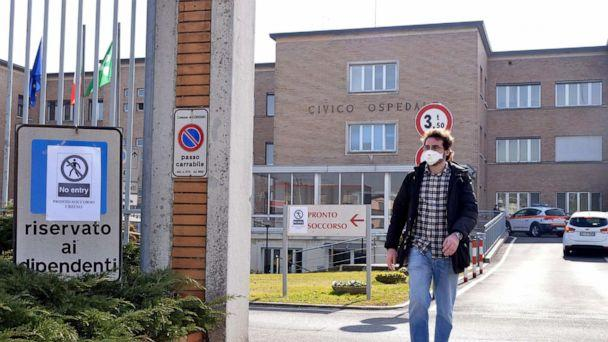 PHOTO: A person wearing a face mask walks out of an entrance gate to the Codogno Civic Hospital, where the emergency room was closed as a precautionary measure, in Codogno, near Lodi, northern Italy on Feb. 21 2020. (MAURIZIO MAULE/EPA-EFE/REX)