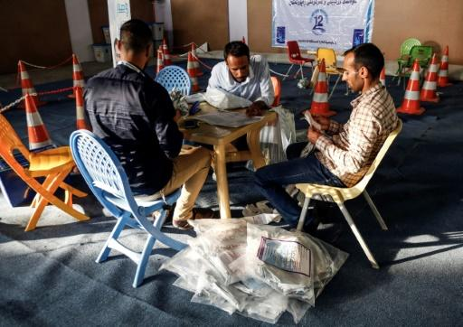 Iraqi electoral commission employees manually count ballots in the central city of Najaf on May 13, 2018