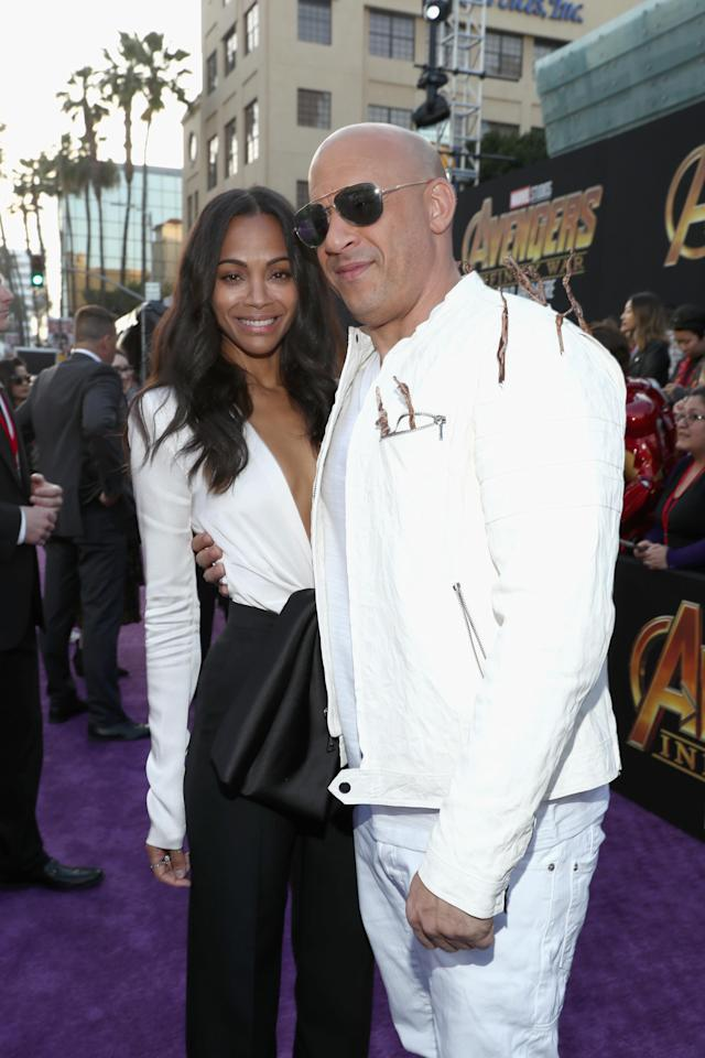 <p>Vin's twiggy jacket was a nod to his <i>Guardians</i> character Groot — and he said cheese with Saldana, who is Gamora. (Photo: Getty Images) </p>