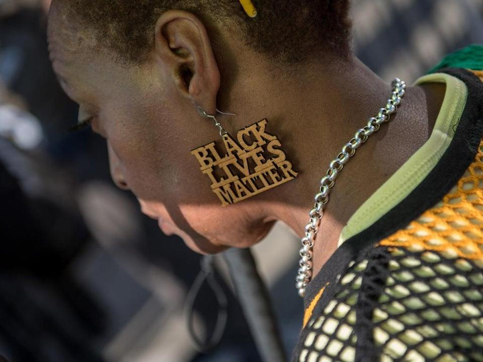 A demonstrator at a protest in support of the Windrush generation in Brixton, London, 20 April 2018 (Getty Images)