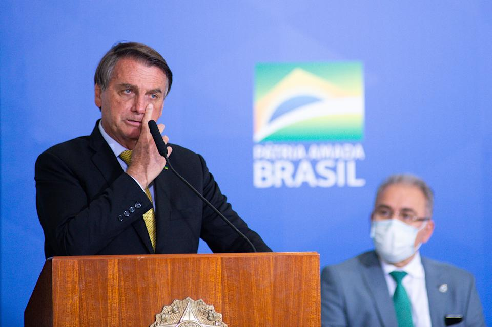 BRASILIA, BRAZIL - JUNE 29: President of Brazil Jair Bolsonaro speaks during an event to launch a new register for professional workers of the fish industry at Planalto Government Palace on June 29, 2021 in Brasilia, Brazil. Health Minister, Marcelo Queiroga,announced after the event and in conversation with journalists, that the contract with the Covaxin vaccine is suspended. (Photo by Andressa Anholete/Getty Images)