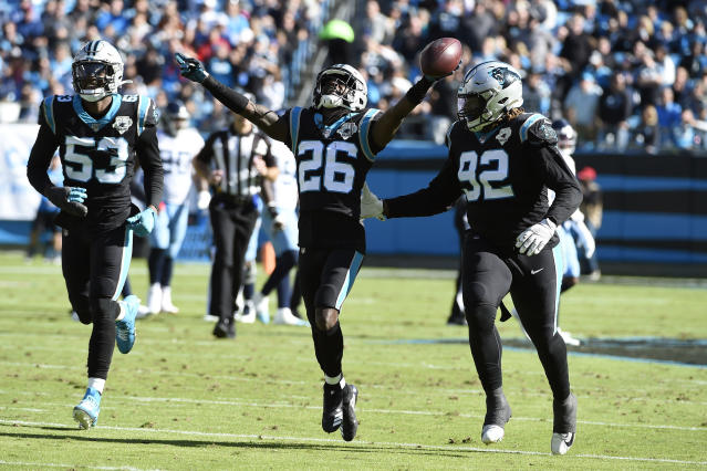 Carolina Panthers cornerback Donte Jackson (26) reacts with linebacker Brian Burns (53) and defensive tackle Vernon Butler (92) after recovering a fumble during the first half of an NFL football game against the Tennessee Titans in Charlotte, N.C., Sunday, Nov. 3, 2019. (AP Photo/Mike McCarn)