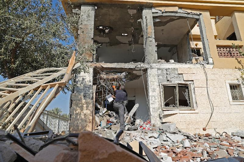 Israeli newspaper Yediot Aharonot said the swift action of a mother in Beersheba who rushed her three children into a safe room as a rocket fired from Gaza largely destroyed their home probably averted a new war (AFP Photo/Jack GUEZ)