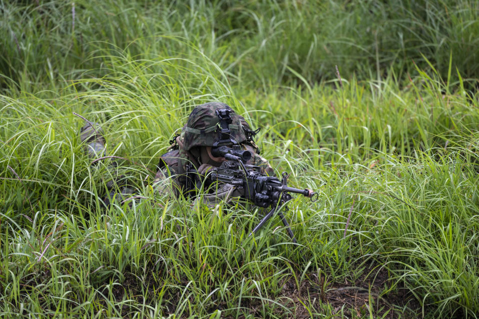A Japan's Self-Defense Force soldier takes part in a joint military drill between Japan Self-Defense Force, French army and U.S. Marines, at the Kirishima exercise area in Ebino, Miyazaki prefecture, southern Japan Saturday, May 15, 2021. (Charly Triballeau/Pool Photo via AP)
