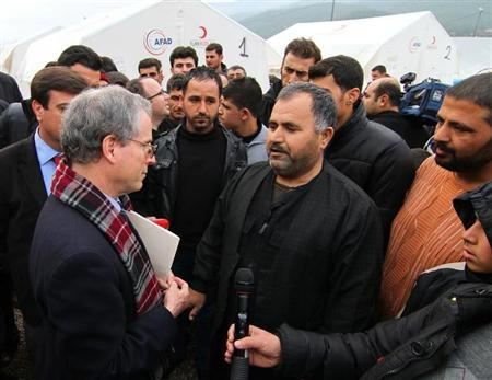 U.S. Ambassador to Syria Robert Ford talks with Syrian refugees as he visits Islahiye refugee camp in Gaziantep
