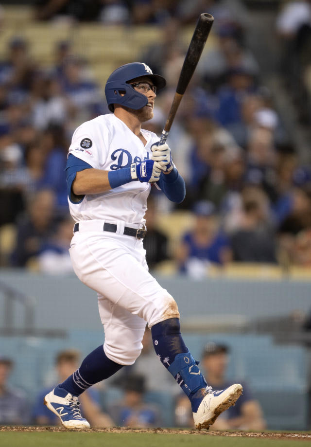 Los Angeles Dodgers' Matt Beaty watches his two-run home run during the second inning of the team's baseball game against the Chicago Cubs in Los Angeles, Friday, June 14, 2019. (AP Photo/Kyusung Gong)