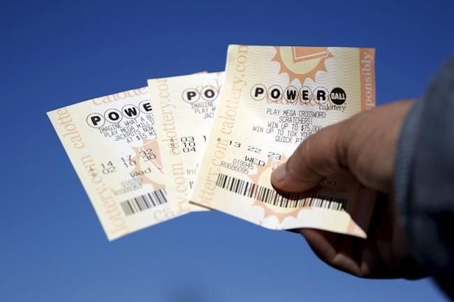 A woman holds Powerball lottery tickets outside Bluebird Liquor in Hawthorne, Los Angeles, California, United States, January 12, 2016. The Powerball Jackpot has reached a record $1.5 billion. REUTERS/Lucy Nicholson