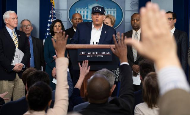 President Trump at a press briefing about the coronavirus pandemic alongside members of the coronavirus task force on Saturday. (Jim Watson/AFP via Getty Images)