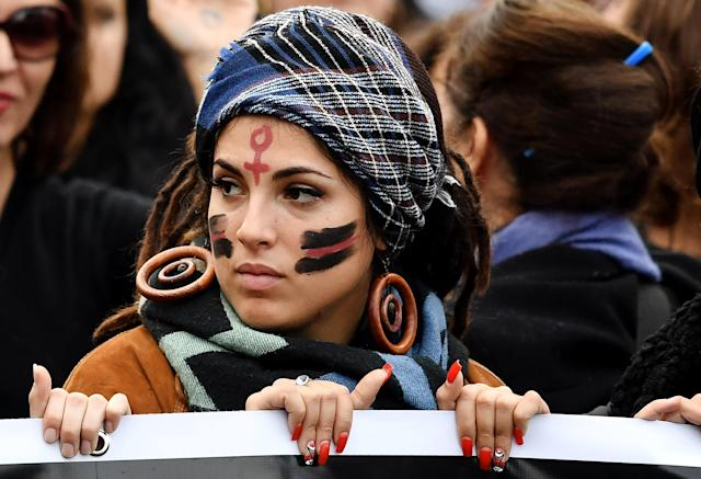 <p>A woman with a Venus symbol for female painted on her forehead takes part in a demonstration to mark the International Day for the Elimination of Violence Against Women in Rome on Nov. 25, 2017. (Photo: Tiziana Fabi/AFP/Getty Images) </p>