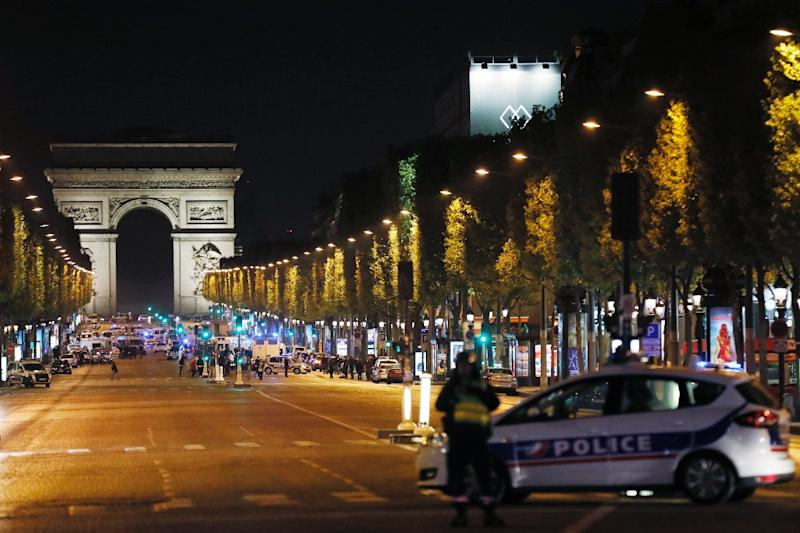 Police block access to the Champs Elysees in Paris after a shooting left one officer dead and two wounded (AFP Photo/THOMAS SAMSON)