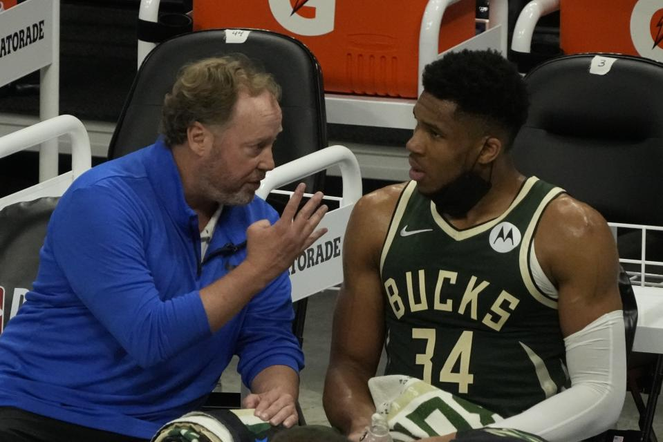 Milwaukee Bucks head coach Mike Budenholzer talks to Giannis Antetokounmpo during the first half of Game 3 of the NBA Eastern Conference basketball semifinals game against the Brooklyn NetsThursday, June 10, 2021, in Milwaukee. (AP Photo/Morry Gash)