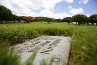A grave marker for an unknown casualty from the USS Arizona is shown at the National Memorial Cemetery of the Pacific on Thursday, July 15, 2021 in Honolulu. Advances in DNA technology have allowed the U.S. military to exhume and identify the remains of hundreds of sailors and Marines buried as unknowns from the bombing of Pearl Harbor, decades after the 1941 attack that launched the U.S. into World War II. But the Defense POW/MIA Accounting Agency, which is responsible for locating and identifying missing servicemen and women, says it won't be able to do the same for those from the battleship that lost the most men that day: the USS Arizona. (AP Photo/Caleb Jones)