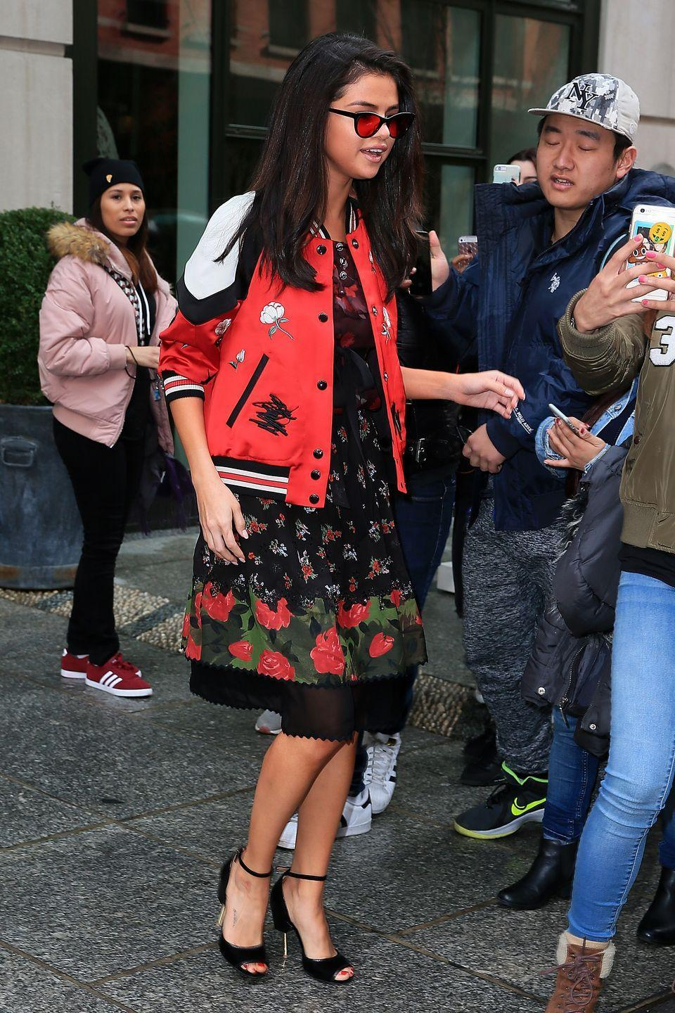 <p>The singer sported a floral-printed midi-dress and red bomber jacket for an appearance in New York City, February 2017</p>