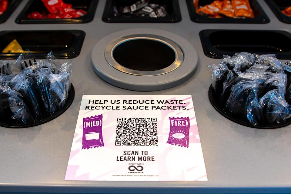 Taco Bell sauce packets, plastic utensils and the QR code for the recycling program