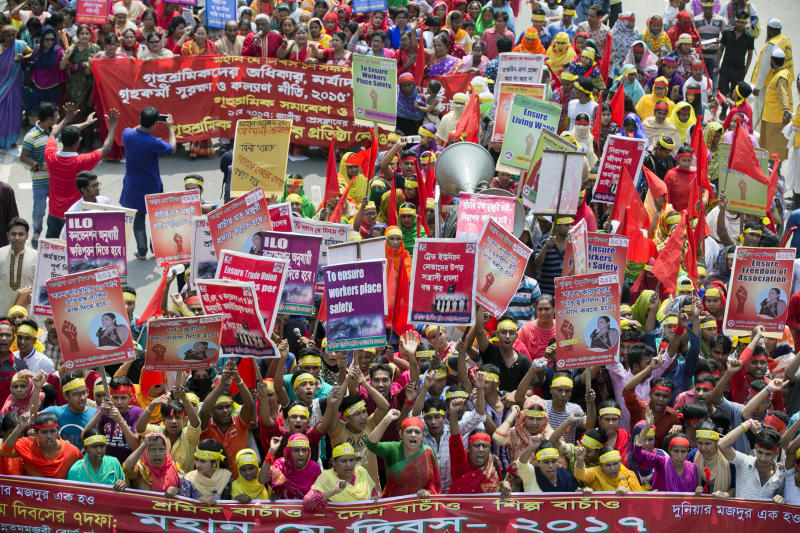 Bangladeshi workers and activists shout slogans as they participate in a May Day rally in Dhaka, Bangladesh, Monday, May 1, 2017. Thousands of workers and activists marched during International Workers' Day demanding higher wages and better work conditions. (AP Photo/A.M. Ahad)
