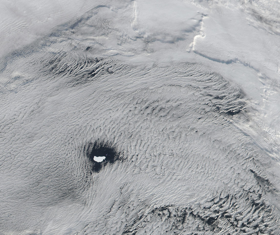 This June 1, 2016 satellite image provided by NASA shows an iceberg floating off the coast of Antarctica beneath heavy cloud coverage. The U.S. National Ice Centre estimates thousands of such icebergs surround Antarctica. A Dubai firm's dream of towing icebergs from the Antarctic to the Arabian Peninsula could face some titanic obstacles. Where many see the crumbling polar ice caps as a distressing illustration of global warming, the company sees it as a source of profit, and a way of offsetting the effects of climate change in the increasingly sweltering Gulf. But the plan faces a daunting array of legal, financial and logistical hurdles _ and environmentalists are less than thrilled. (NASA via AP)