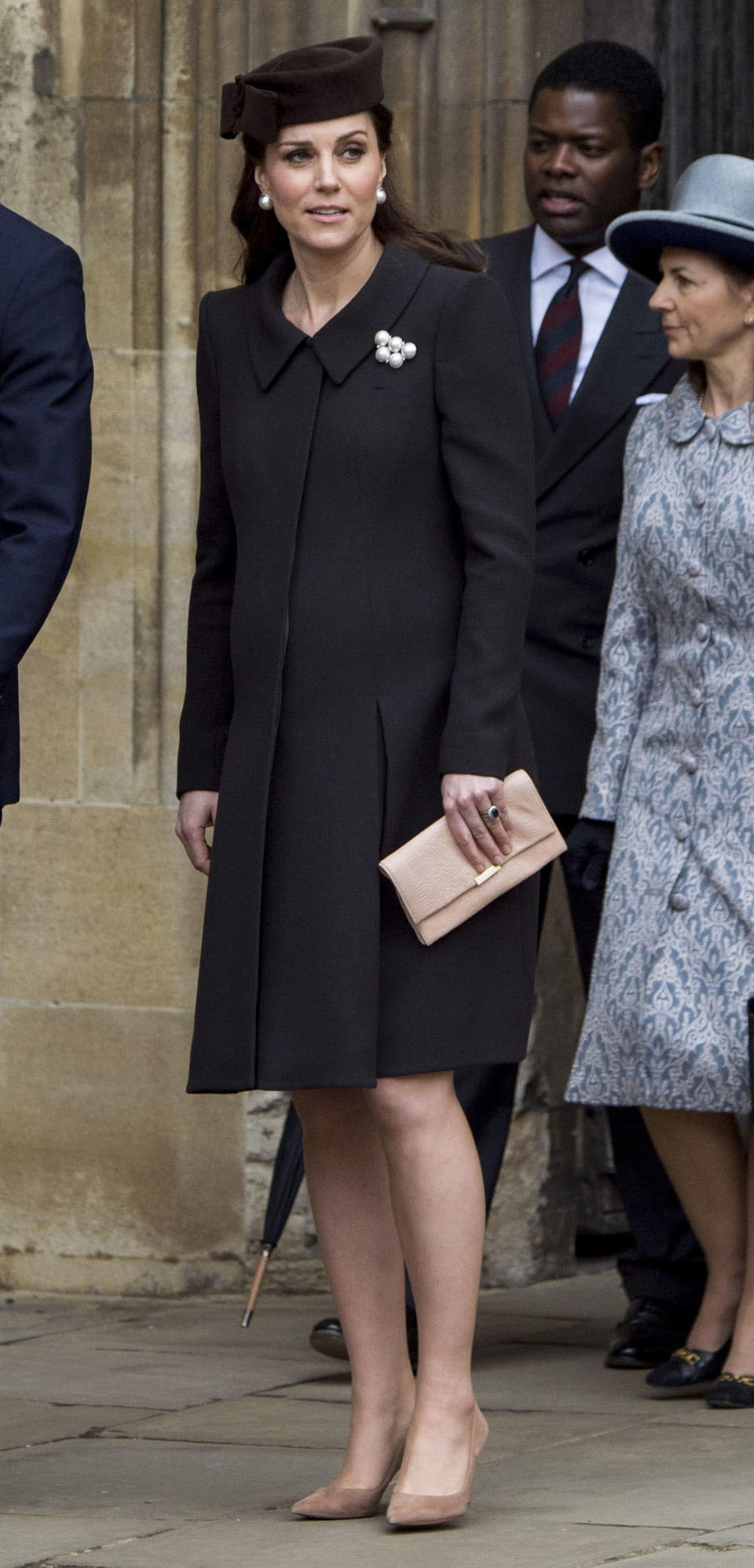 <p>Catherine, Duchess of Cambridge, wears a black coat with a fur hat and nude pumps at the Easter Service at St. George's Chapel on April 1, 2018, in Windsor. (Photo: Getty Images) </p>