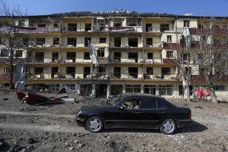 FILE PHOTO: A view shows a damaged building following recent shelling in Shushi