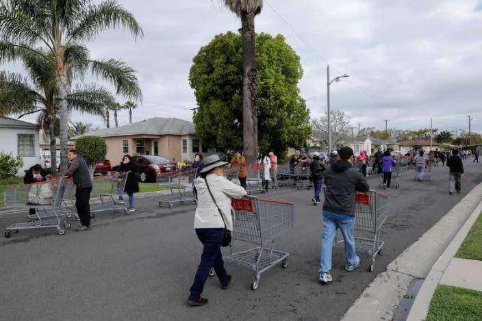 Hundreds of shoppers line-up for blocks waiting to purchase supplies at a Costco due to the global outbreak of coronavirus in Garden Grove, California